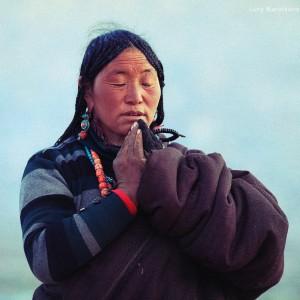 tibetan pilgrim woman is praying