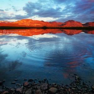 lake at sunset in iceland