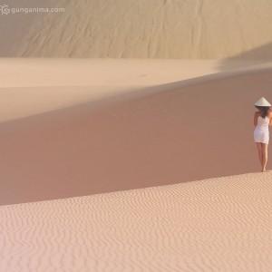 woman in desert in dunes in vietnam