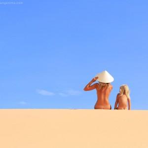 mother and kid in vietnam sands in desert