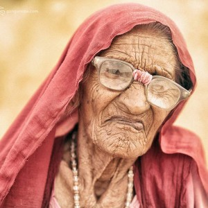 old woman in tar desert in rajastan in india