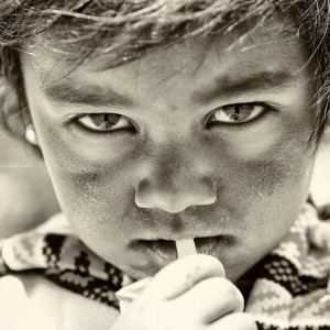 white and black photo of child in nepal
