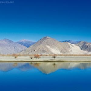 clear blue lake near lhasa in tibet