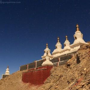buddhist stupa in the night in tibet