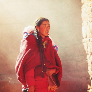 tibetan woman and a child in tibet in sershul monastery