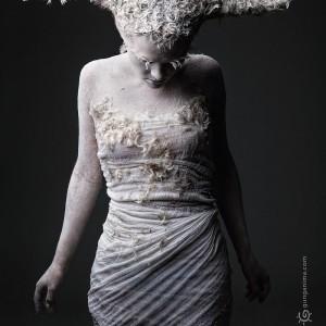studio photo portrait of woman in costume of moth