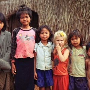 girl with blond hair in cambodian village
