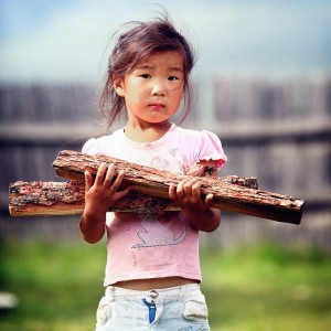 girl in buryatia with wood in hands