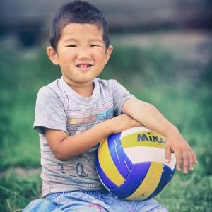 buryat boy with football ball in russia