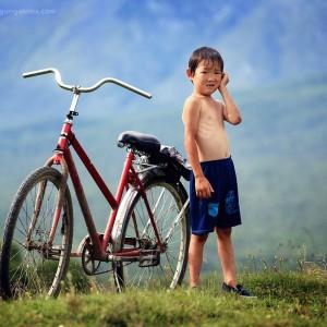 boy and a bike in russia
