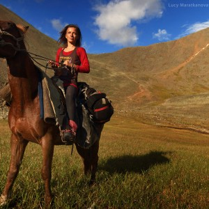 woman on horse in shumak pass in baika in russia