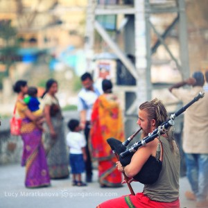 european man is playing bagpipes in rishikesh in india