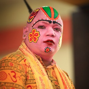 man with colored face in india
