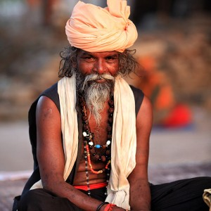 hindu in turban in lotus position in haridvar in india