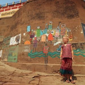 white girl at the walls of Varanasi in india