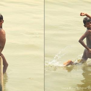 indian boy in gang river in varanasi in india