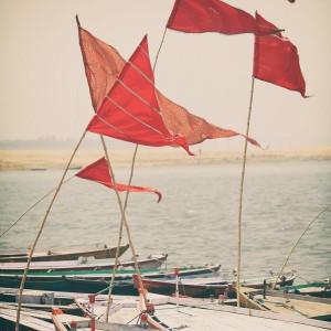 flags on boats in varanasi in india