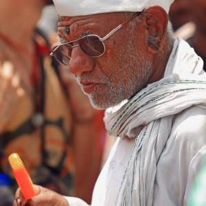 old hindu man in white dress in varanasi in india