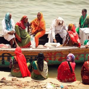 women in boats in varanasi in india
