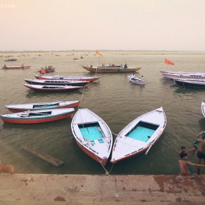 boats on the shore in varanasi in india