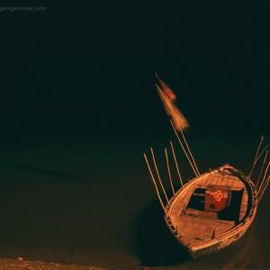 boat on the shore in varanasi in india
