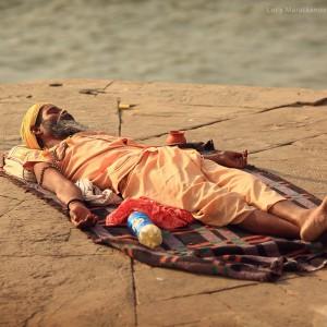man is having rest in varanasi in india