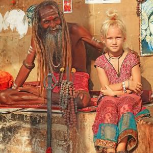 white girl and sadhu in varanasi in india