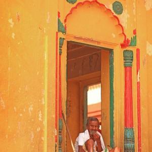man is sitting in the windowin varanasi in india