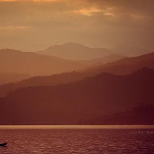 sunset on phewa lake in pokhara in nepal