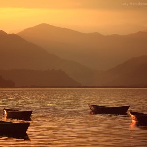 sunset and boats on phewa lake