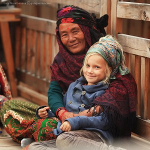 girl and old woman in nepal near annapurna