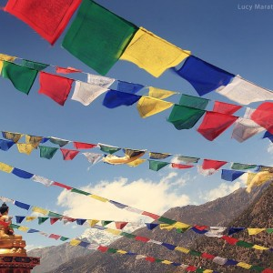 prayer flags in sky in mountains in nepal