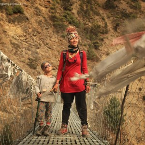 mother and daughter on hanging bridge in nepal