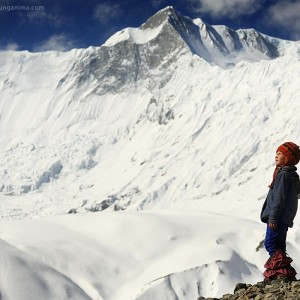 little girl in snowy mountains near annapurna in nepal