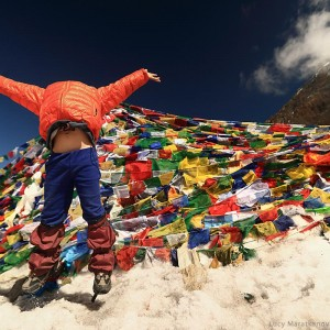 girl is happy to be in thorong la pass in nepal in annapurna