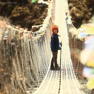 girl on hanging bridge in nepal