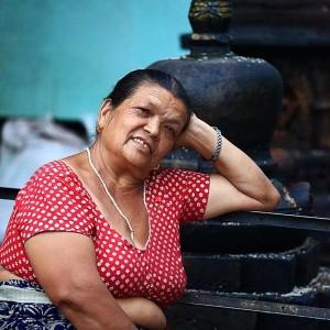 woman at stupa in kathmandu in nepal