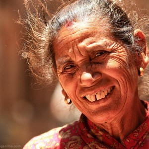 old nepali woman is smiling in kathmandu