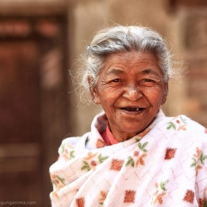 nepali old lady is smiling in bhaktapur