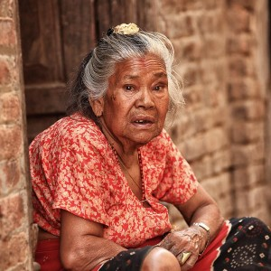 Old woman sitting in Bhaktapur