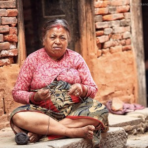 Nepali old woman knitting