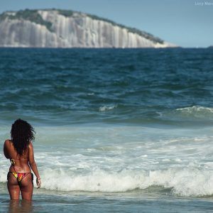 brazilian woman in swimming suit in the sea in rio de janeiro in brasil