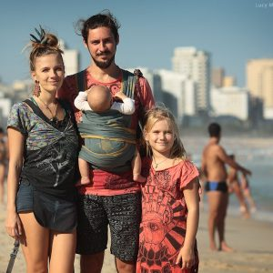 family rest in rio de janeiro on the beach in brazil